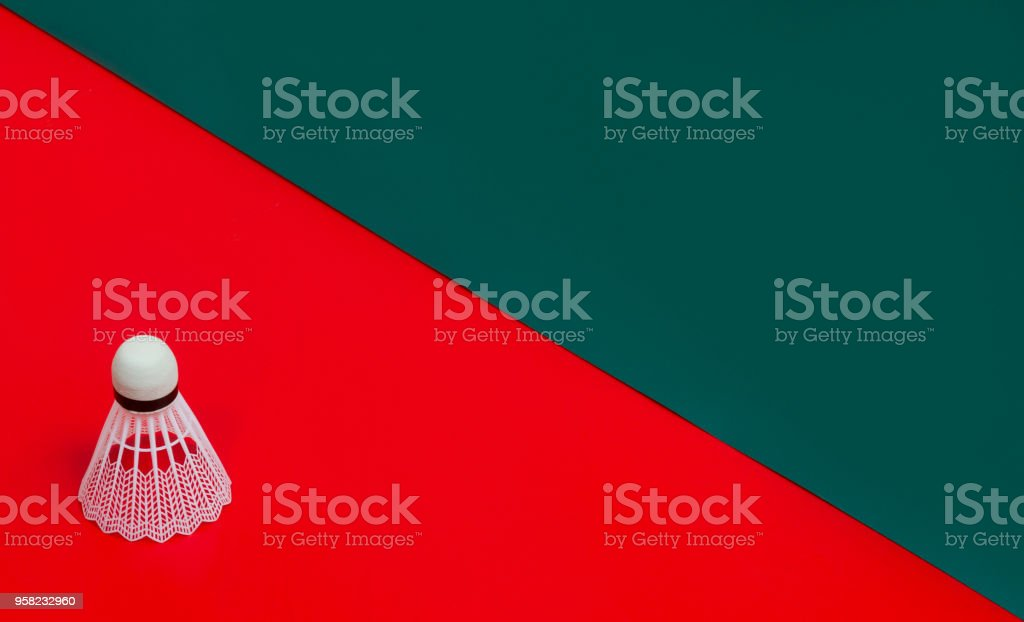composition with badminton shuttlecocks placed on red and green background stock photo