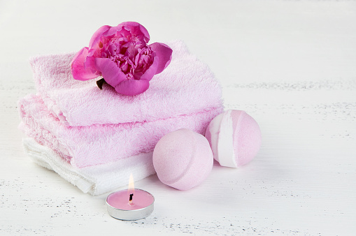656780900 istock photo SPA composition with bath bombs and pink peony 994786552