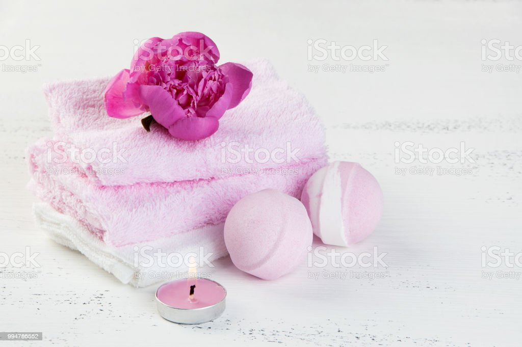 SPA composition with bath bombs and pink peony stock photo