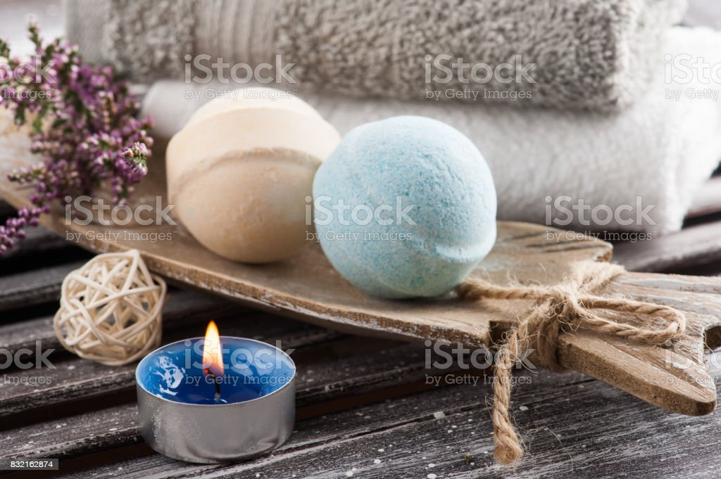 SPA composition with blue vanilla bath bombs, heather flowers stock photo