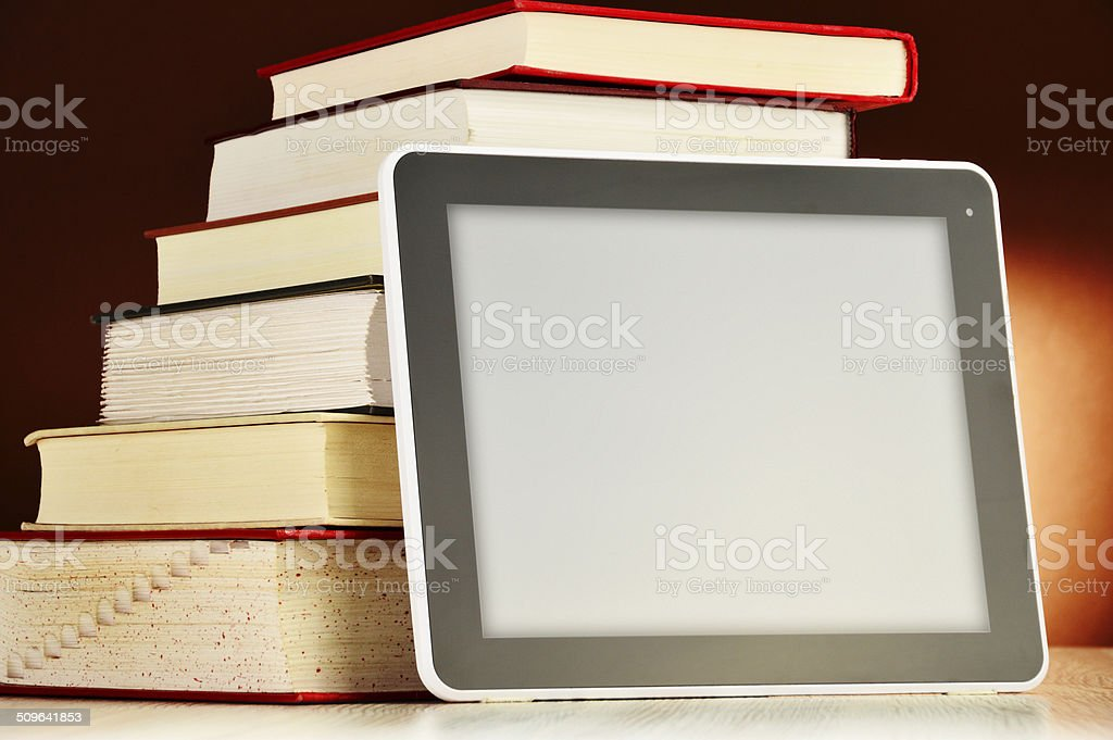 Composition with books and tablet computer on the table stock photo