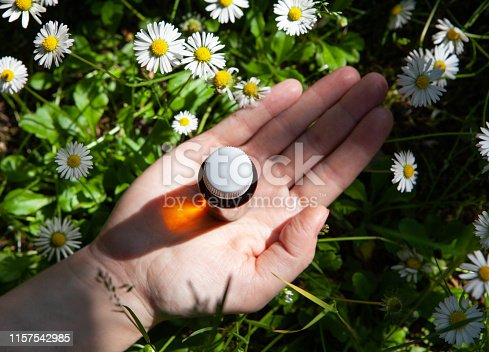 istock Composition with bottles of chamomile essential oil. 1157542985