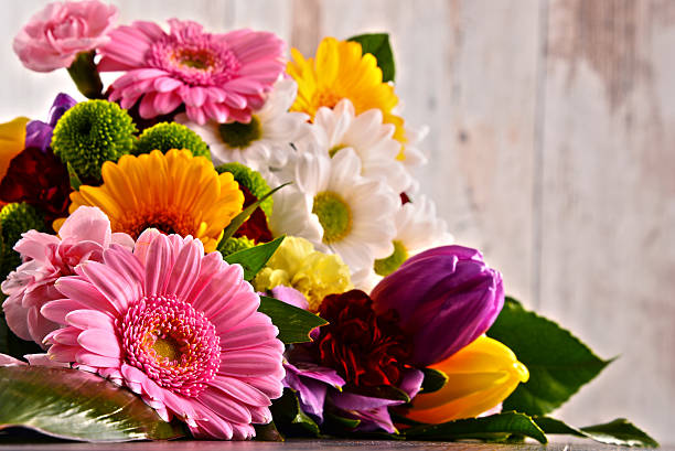 composition with bouquet of flowers - flowers stock photos and pictures
