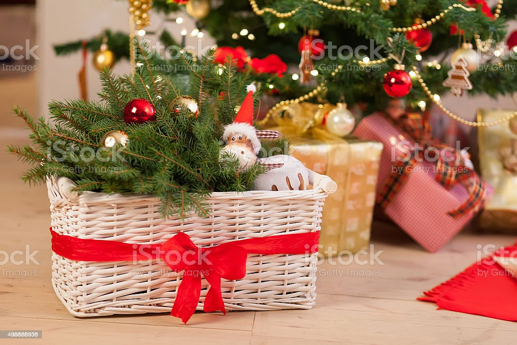 composition with christmas decorations in basket royalty free stock photo