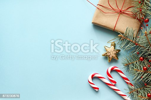 istock Composition with Christmas gift box, fir tree branch, candy canes. 873230876