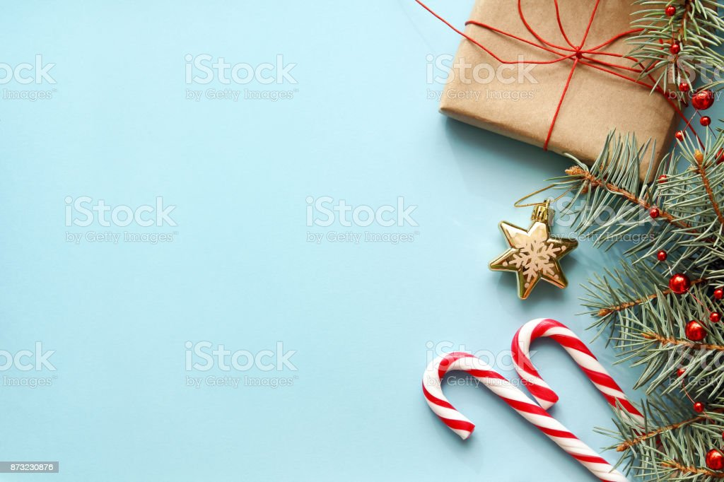 Composition with Christmas gift box, fir tree branch, candy canes. stock photo