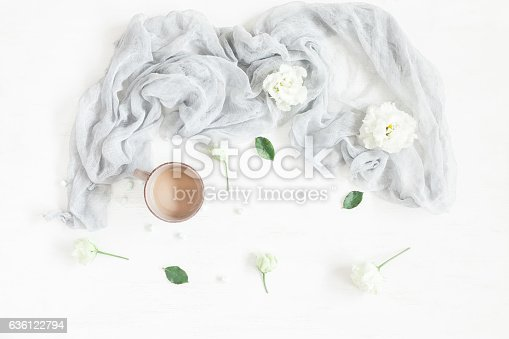 istock Composition with coffee and white flowers. Flat lay, top view 636122794