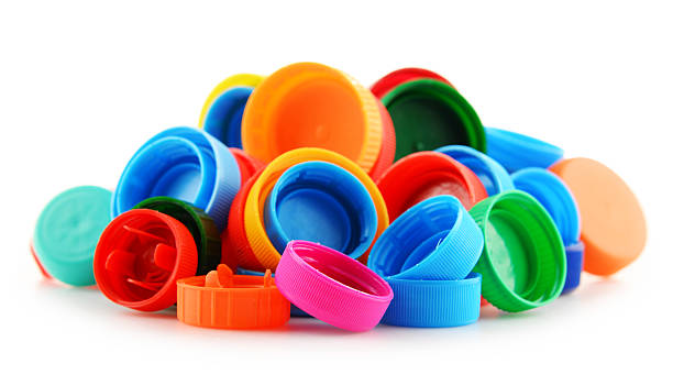 composition with colorful plastic bottle caps - plastic cap stock pictures, royalty-free photos & images
