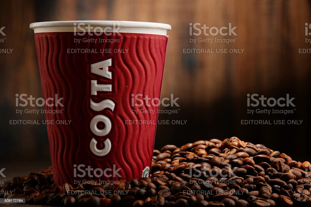 Composition with cup of Costa Coffee coffee and beans stock photo