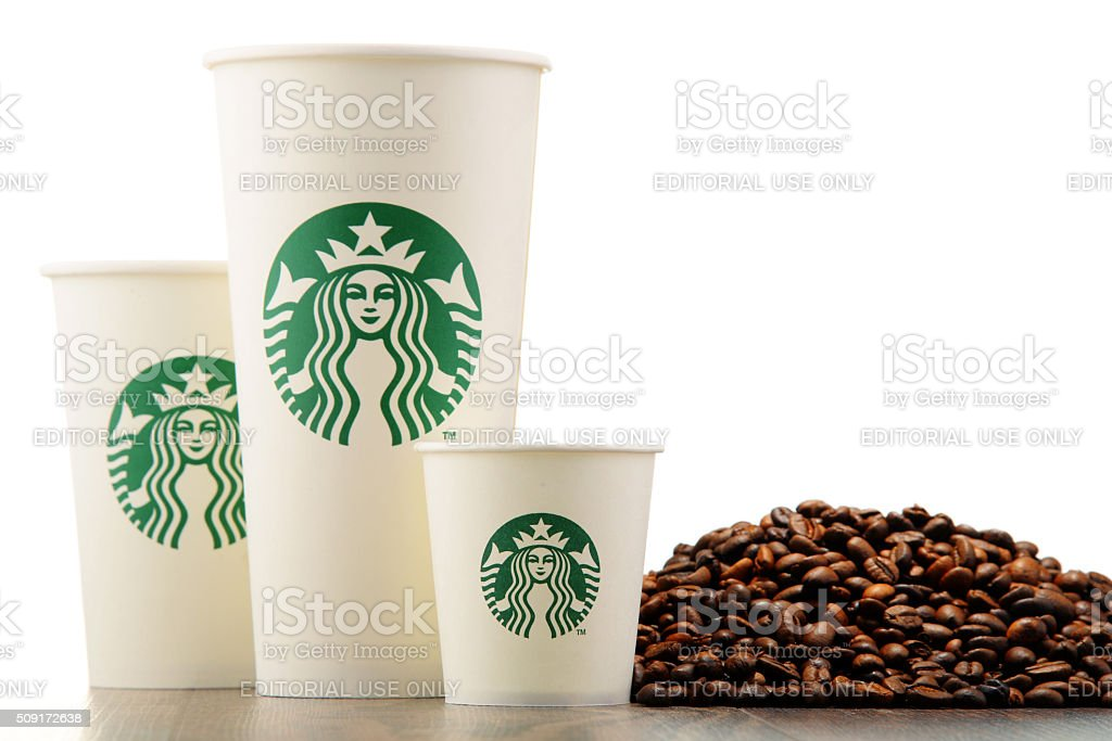 Composition with cup of Starbucks coffee and beans stock photo