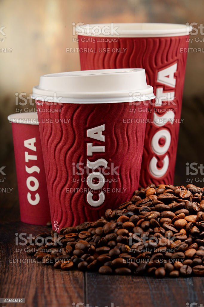 Composition with cups of Costa Coffee coffee and beans stock photo