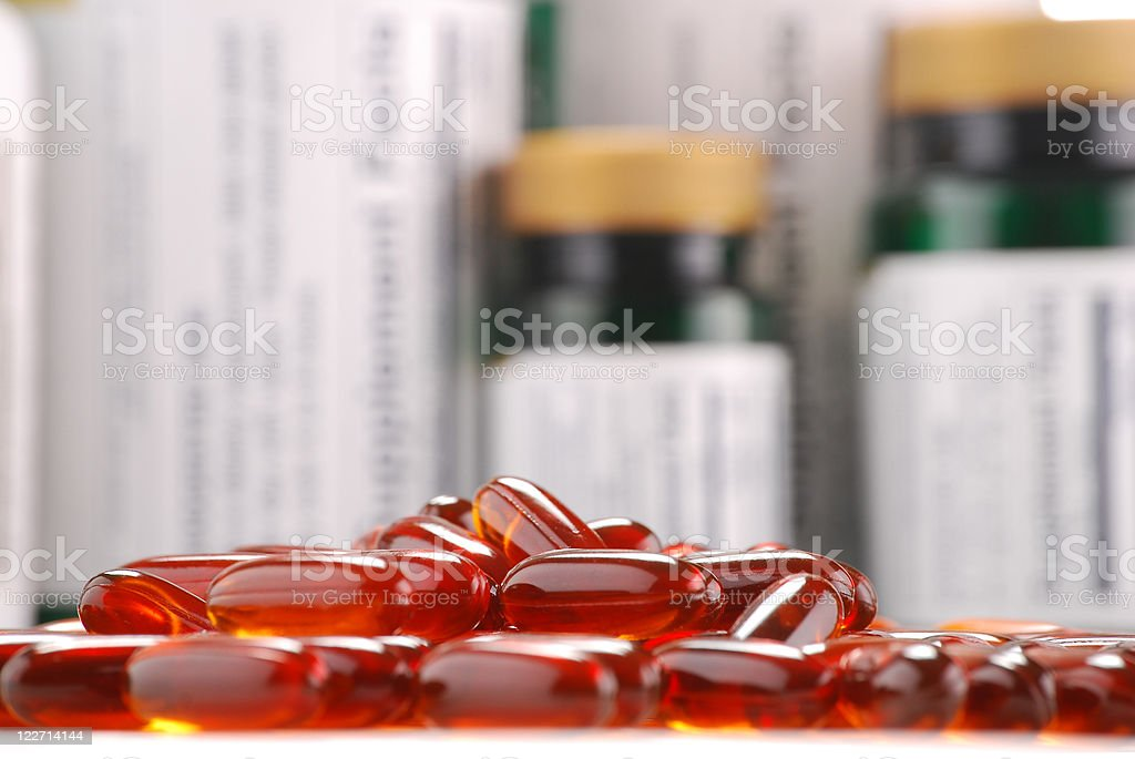 Composition with dietary supplements capsules and containers royalty-free stock photo