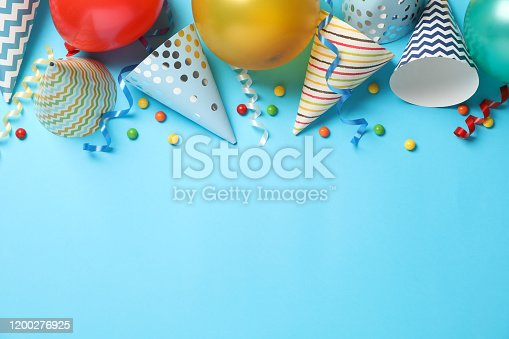 Composition with different birthday accessories on blue background, space for text