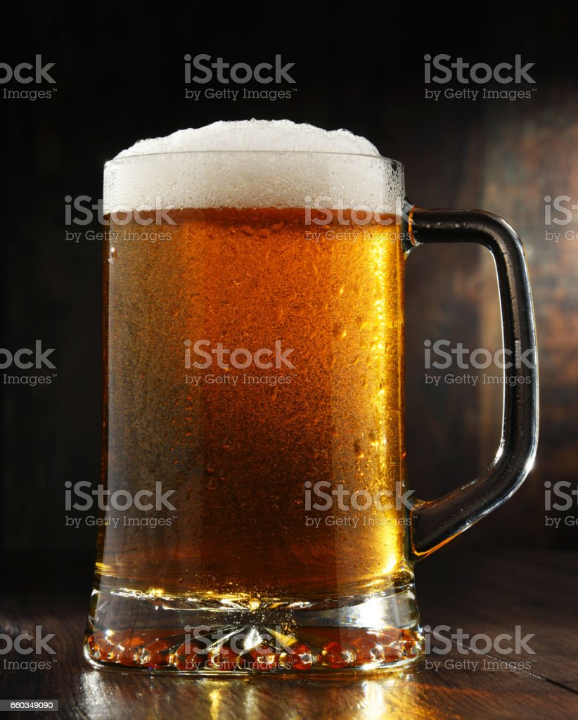 Composition with glass of beer on wooden background stock photo