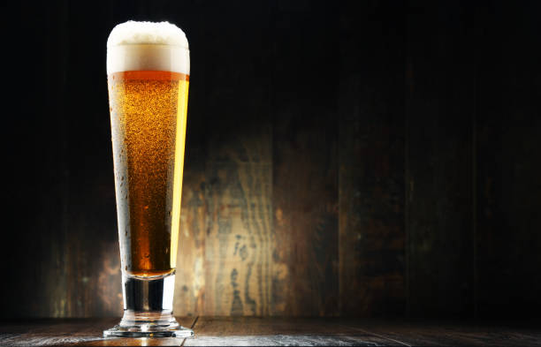 Composition with glass of beer on wooden background Composition with glass of beer on wooden background. pilsner stock pictures, royalty-free photos & images