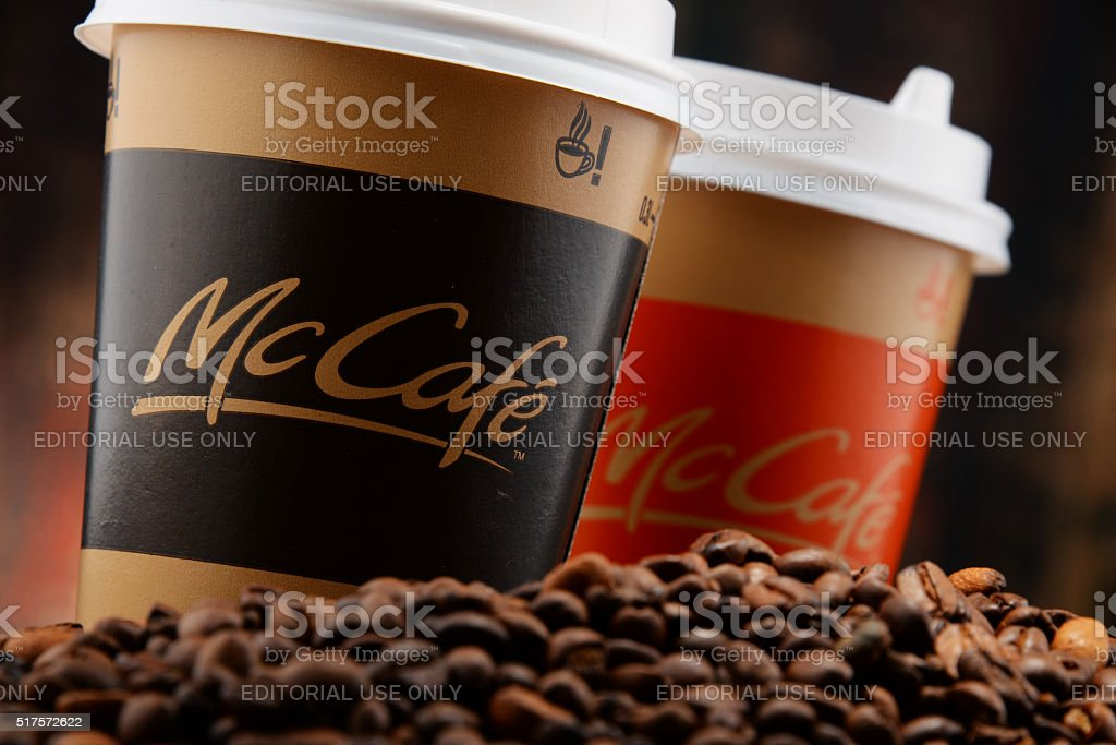 Composition with McCafe coffee cup and beans stock photo