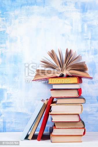 508711370 istock photo Composition with old vintage colorful hardback books, diary on w 515433764
