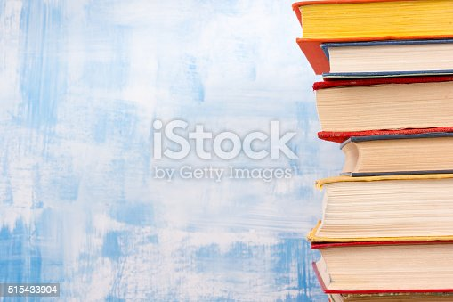508711370 istock photo Composition with old vintage colorful hardback books, diary on w 515433904