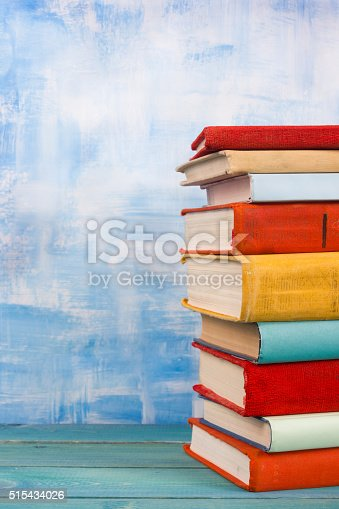 508711370 istock photo Composition with old vintage colorful hardback books, diary on w 515434026