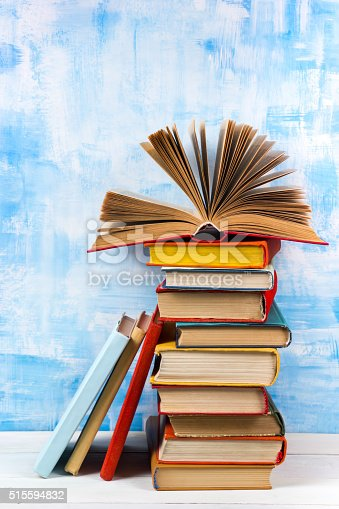 508711370 istock photo Composition with old vintage colorful hardback books, diary on w 515594832