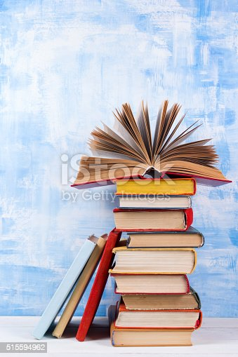 508711370 istock photo Composition with old vintage colorful hardback books, diary on w 515594962