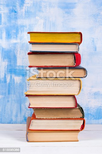 508711370 istock photo Composition with old vintage colorful hardback books, diary on w 515595086