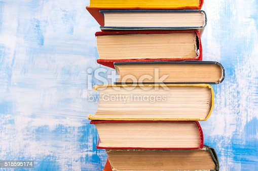 508711370 istock photo Composition with old vintage colorful hardback books, diary on w 515595174