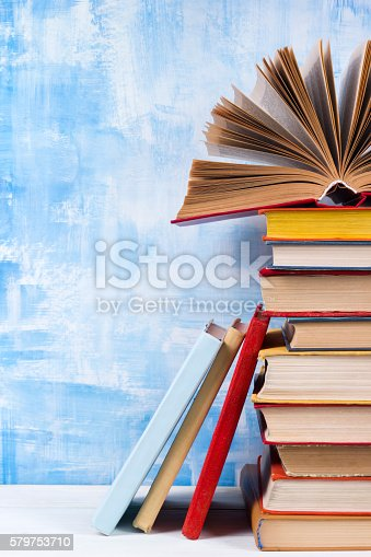 508711370 istock photo Composition with old vintage colorful hardback books, diary on w 579753710