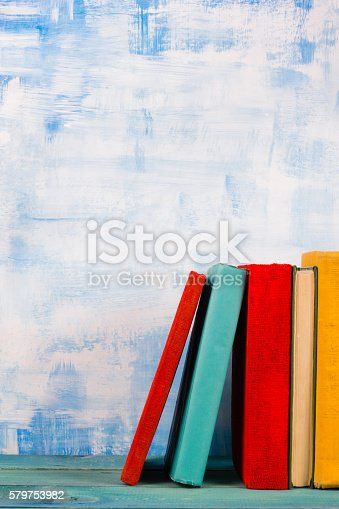 508711370 istock photo Composition with old vintage colorful hardback books, diary on w 579753982