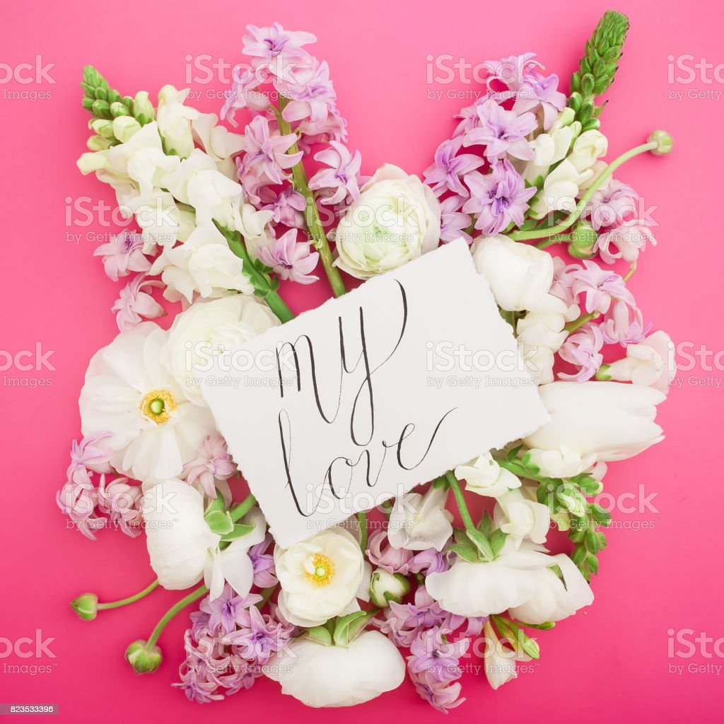 Composition With Paper Card And Flowers On Pink Background Quote On