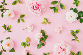 istock Composition with roses and leaves on pastel pink background. Flat lay, top view. 1060830822