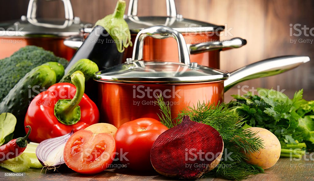 Composition with set of pots and raw vegetables stock photo