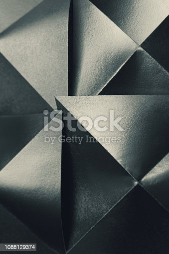istock Composition with silvery paper, abstract background 1088129374