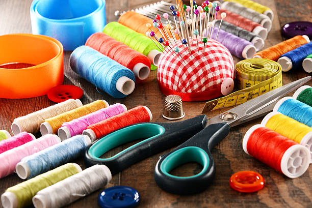 Composition with tailor accessories on wooden table stock photo
