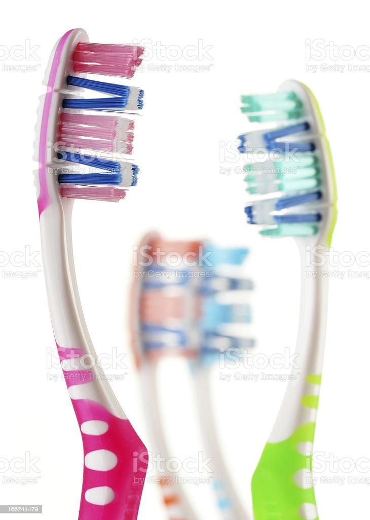Composition with toothbrushes isolated on white royalty-free stock photo
