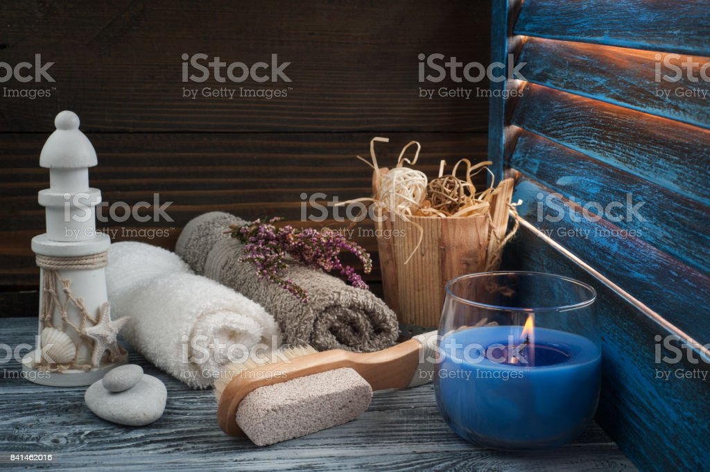 SPA composition with towels, brush, lit candle stock photo