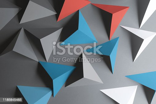 157434064istockphoto Composition with triangular shapes, gray background 1185845465