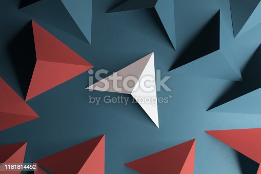 Red and white triangular shapes of paper, abstract