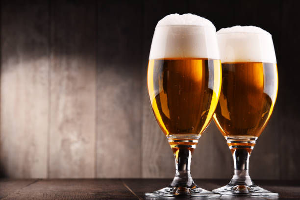 Composition with two glasses of lager beer Composition with two glasses of lager beer. pilsner stock pictures, royalty-free photos & images