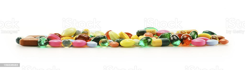 Composition with variety of drug pills isolated on white royalty-free stock photo