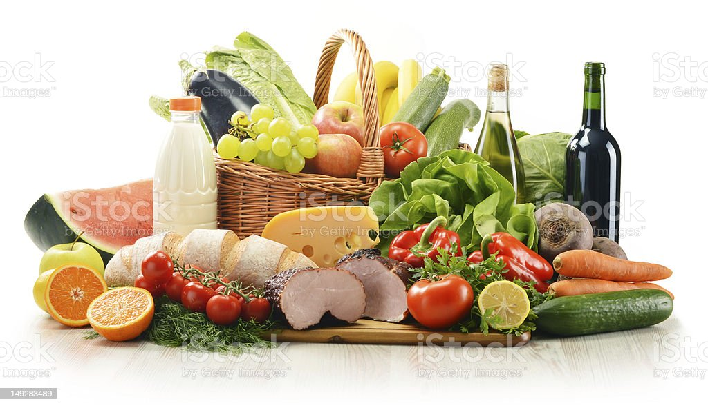 Composition with variety of food products in wicker basket stock photo