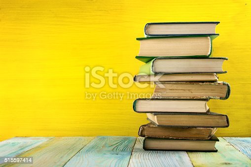 istock Composition with vintage old hardback books, diary, fanned pages 515597414