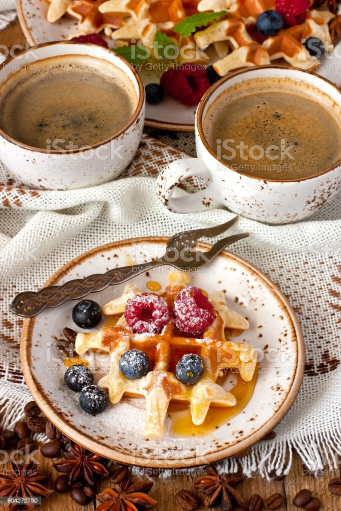 Still life with sweet dessert waffles and coffee cup