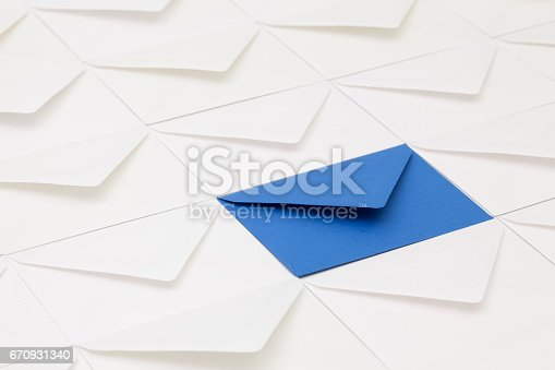 istock Composition with white envelopes and one dark blue  envelope 670931340