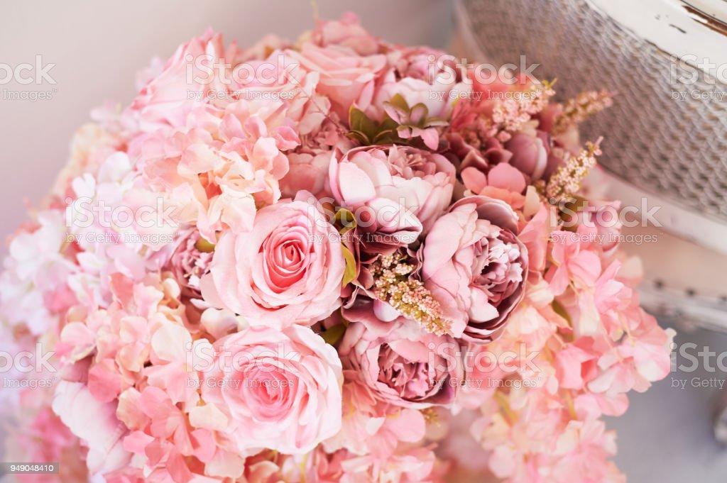 Compositions of pink flowers in the interior. Wedding photo zone.Romantic space decor stock photo