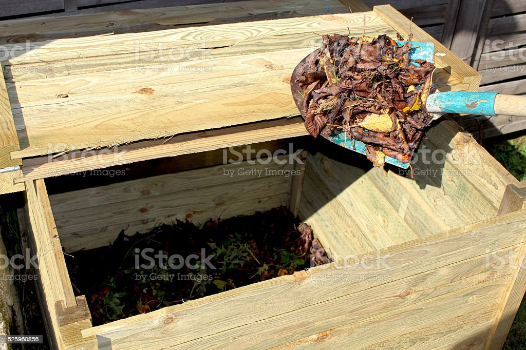 Composter and shovel stock photo