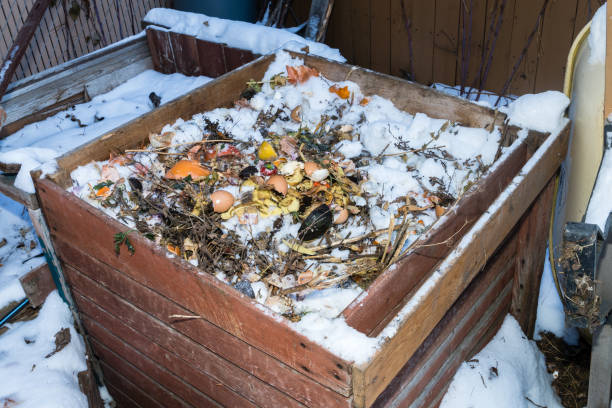 Composting box in winter season with snow stock photo