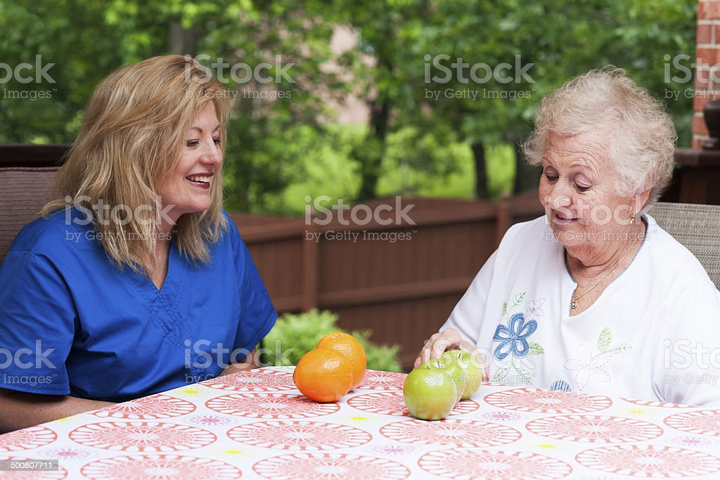 Comprehension training during speech therapy for aphasia stock photo