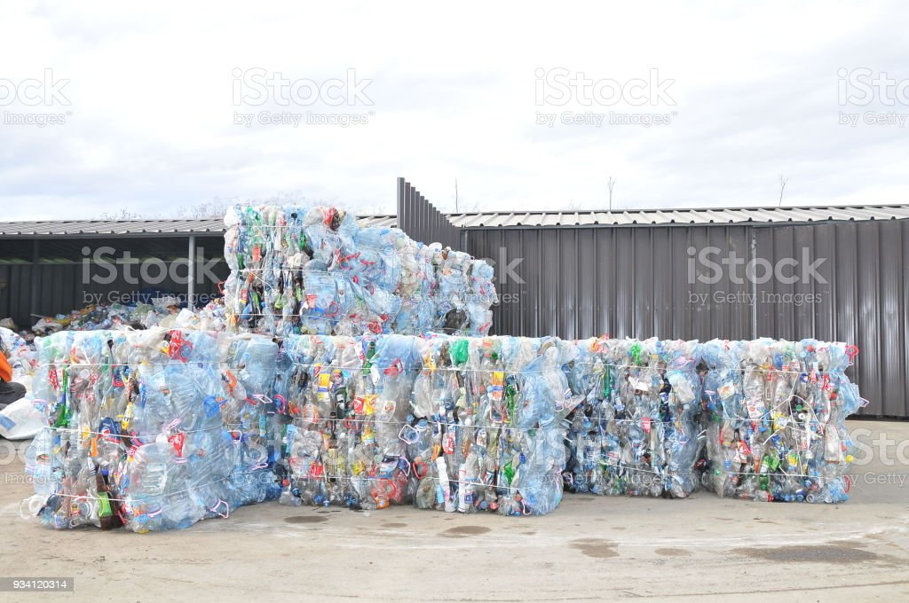 Compresed plastic bottler ready for recycling stock photo