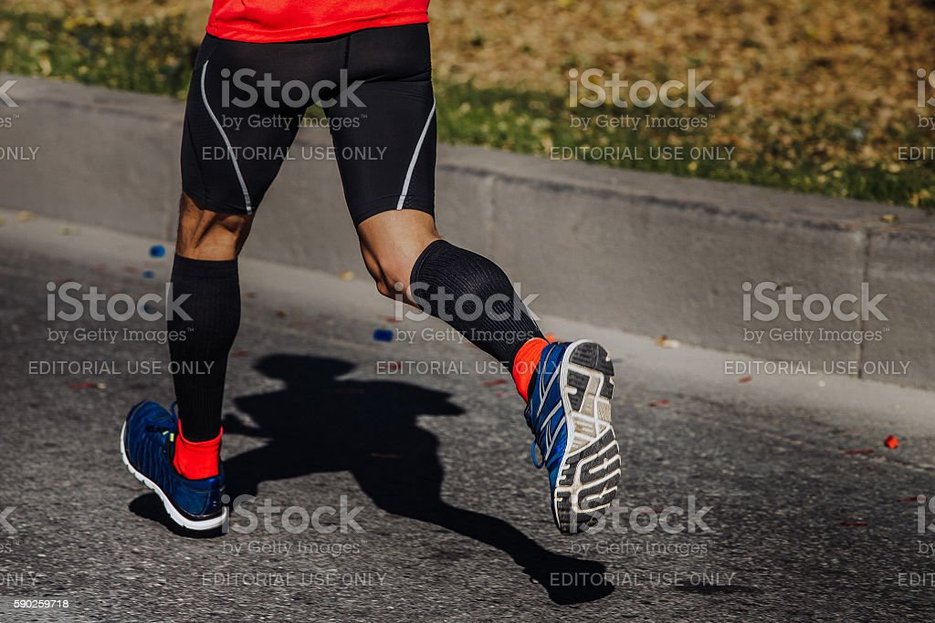 compression socks on feet of a man stock photo